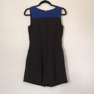 Black and blue jewel neckline romper